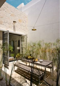 would love to have an outside area off the kitchen.... just needs some cool lightbulb string lights....