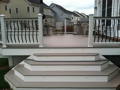 An AZEK deck with Trex railings with Baroque balusters. Lighting is low voltage LED lighting. Deck in Brambleton by Blue Moon