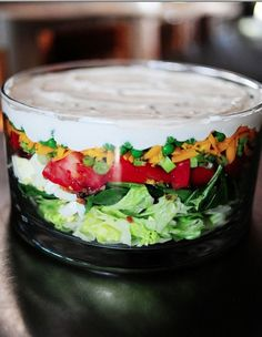 Pioneer Woman's layered salad recipe. Could totally make these in mason jars to eat on the the go.