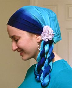 artsy twist headscarf as usual, you would have to adjust this to cover the neck (or wrap it over a separate amira.. but i love the look...