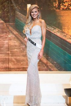 Miss Alabama USA 2016 Evening Gown  Blonde Bombshell Peyton Brown will represent the state of Alabama at the upcoming Miss USA pageant. She impressed the judges in a sultry, yet delicate evening gown style.