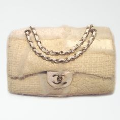 5e4e800db1b7 This authentic Chanel flap bag is a true classic. The exterior is made of  white mixed media with lamb leather