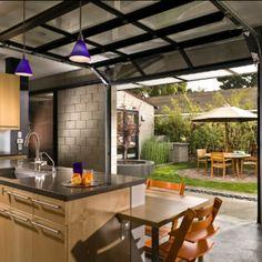 Using Glass Garage Doors To Open Up Interior Spaces