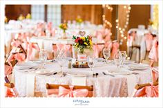 The Columbia Ballroom reception decor in coral and pink with mason jars, burlap and lace.