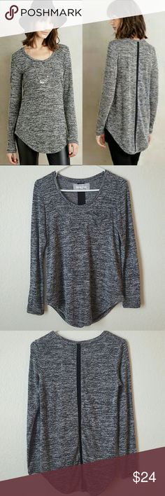 """Anthropologie Pure + Good slubbed baseball tee Pure + Good for Anthropologie """"slubbed baseball tee"""" in marled grey. Slouchy knit top with pocket and a strip of black grosgrain going down the back.   Excellent condition   Size small. Underarm to underarm 17"""" length 28"""" in front 29.5"""" in back   Polyester/rayon/spandex blend Anthropologie Tops"""