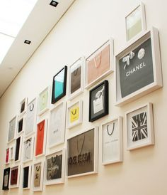 Framed shopping bags as walk-in closet decor.