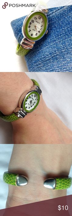 Green faux skin watch A cheerful green watch with silver accents that adds a splash of personality to your outfit. The band is covered in a faux alligator skin, and is hinged on either side of the face to allow easy on and off. Hinges do not pinch and the band is made for a smaller wrist. True color is seen in cover photo. Needs a new battery but works perfectly. ❣Make an offer!❣❌No trades!❌ Accessories Watches