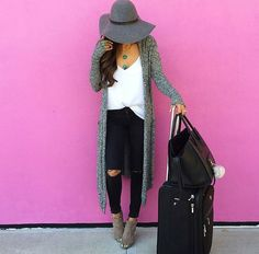 White tee, black ripped jeans, long grey cardigan.