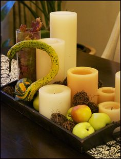 Fall candle display for the dining room table...http://www.curatorsoflifestyle.com/blog/article/bringing-autumn-into-my-home