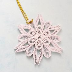 Quilled snowflake ornament.  Diameter: 70mm  Quilling strips: 3mm  Please let me know through ETSY Conversation if you have any questions!  Thank you.