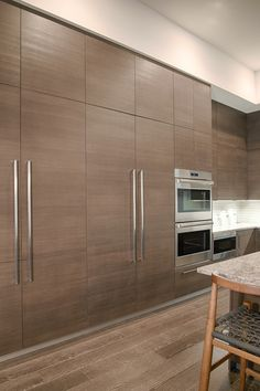 Kitchen in Divco Custom Homes Model in Miromar Lakes. Divco Homes | Naples, FL | Divcohomes.com
