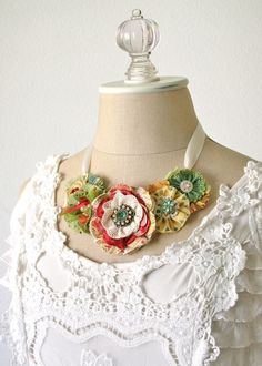 Cute flowers - love the different fabrics and laces. Not a tutorial, but great inspiration.