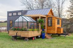 Elsa by Olive Nest Tiny Homes - - Elsa is a tiny house complete with a pergola-covered porch, a swing, and a greenhouse that's sure to make plant lovers swoon. Tiny Houses For Rent, Best Tiny House, Modern Tiny House, Tiny House Living, Tiny House Plans, Tiny House On Wheels, Tiny House Design, Barn House Plans, Cabin Plans