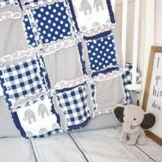 Custom handmade elephant baby boy crib bedding. The nursery bedding featuring elephants, is made in navy blue and gray fabrics of the highest quality including a navy buffalo plaid, elephant print, polka dots. Sold as a crib set or the rag quilt only. Also perfect as a gender neutral crib bedding or for your little girl  #ragquilt #babyquilt #elephantnursery