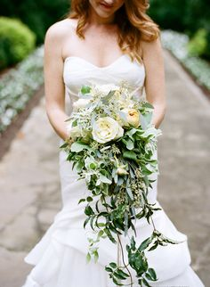 Gorgeous cascading green and ivory bouquet by Jessica Sloane Event Styling & Design, image by Austin Gros, dress by Monique Lhuillier.