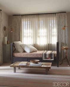 Mark Cunningham: Lone Star Statement--In the master bedroom's sitting area, an Arts and Crafts daybed with a Navajo throw is flanked by early-20th-century sconces; the cabinet and side table are 19th century, and the cocktail table is from the 1950s.