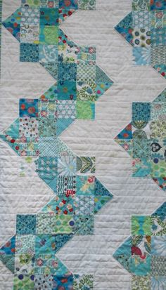 Such a pretty, peaceful quilt, I like the horizontal quilting; it's hand-quilted.