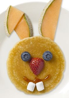 Kids Creative Meal Idea ~ Easter Breakfast ~ Easter Bunny Pancake | Kick off the day in true Easter style with these adorable bunny pancakes. This delicious meal is not only easy to make (you don't even have to shape the batter) but the fruit accessories make it a balanced meal that will give your kids the energy they need to kickstart their day. Pancake, cantaloupe, blueberries, strawberries, syrup