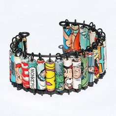 Paper Bead Jewelry- Upcycled Comic Book & Steel wire Bracelet Cuff by Tanith Rohe http://www.etsy.com/shop/Tanith