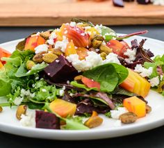 Beautiful beet salad with orange vinaigrette, pistachios, and goat cheese