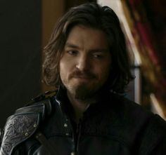a Rare thing for Athos...that smile <3