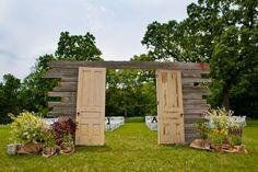 Beautiful entryway for a rustic, outdoor wedding.  vintage doors. refurbished doors. doors and weddings. rustic wedding. vintage wedding. outdoor weddings. wedding ideas.