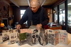 Artist and illustrator Antonio Frasconi opens a handmade accordion book of some of his woodblock prints