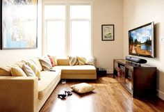 """An open area at the top of the stairs left a """"what to do?"""" space. This flat-panel TV and soundbar gave it an identity."""
