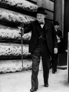 Winston Churchill walks to Parliament to announce the D-Day landings in June 1944 during World War II.