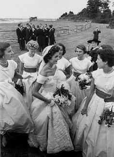 "Jacqueline Bouvier wedding day 1953 (©Lisa Larsen)  I love this because of the natural ""separation"" between boys and girls that always happens at weddings but is never captured so obviously or perfectly!!"
