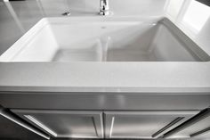 Engineered stone counter top, gray cabinets, with under mount white cast iron sink, doesn't get much better than that!