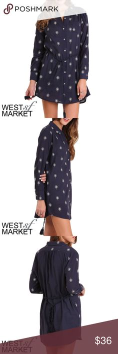 The Cassie Dress Navy button-up shirt style dress with graphic dandelion print. Features a versatile fringed waist tie that can cinch the waist or tie behind the back! West Market SF Dresses Mini