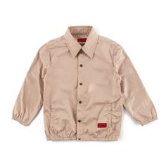 Carter Coaches Jacket (Creme)-Unisex. LUSH SATIN FABRIC JACKET. SLIGHTLY EXTENDED LENGTH. SNAP BUTTON CLOSURE. SINGLE WELT FRONT POCKETS. ELASTIC AT SLEEVE CUFF AND BOTTOM HEM.MACHINE WASH COLD. STEAM OR IRON WITH LOW HEAT. LINE DRY. DO NOT BLEACH.100% POLYESTER.