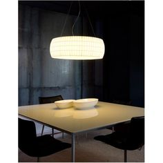 Isamu Pendant features a bookbinding tape shade with a polycarbonate diffuser, available in white or black. 2 100watt A19.  30.3W x 10.2H