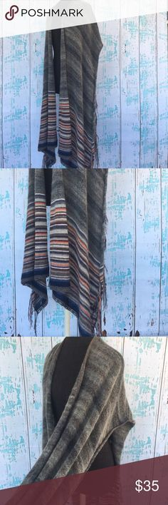 Free People fringe poncho gray with stripes Free People fringe poncho gray with stripes. Size is technically M/L but could fit S-L technically. It's been washed so has that look to fringe but no tears or rips. Lots of life left. Free People Sweaters