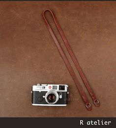 $34 | Leather Camera Strap | Classic Rangefinder Camera Strap | Reddish-Brown Color #handmadeleather #leathergifts #camerastrap #cameraaccessories #leathercamerastrap