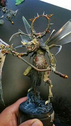Not sure what the model is based on but it is definitely a winged demon prince of Nurgle.