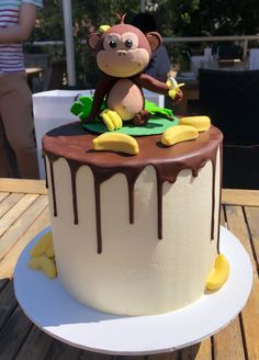 First birthday cake - vanilla and chocolate cake with coconut buttercream and chocolate drip. Decorated with handmade polymer clay monkey topper and banana lollies. 22nd Birthday Cakes, Monkey Birthday Cakes, Boys First Birthday Cake, Monkey Birthday Parties, Monkey Cakes, Birthday Ideas, Fondant Figures, Dad Cake, Safari Cakes
