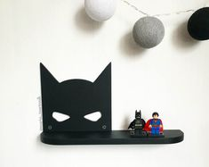 Shelf Batman   DIMENSIONS: height - 165 mm (6.5 inches) width - 300 mm (11.8 inches) depth - 70 cm (2.8 inches)  If you need a different size or color, i can do it))  Ideal for children or fans of comic book characters. You can hang it on the wall for example. It also makes a beautiful gift.  # Shelf is sold without a LEGO #
