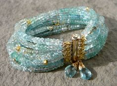 The Isabeau Redux is made with ten strands of watery, transparent aquamarine (March's birthstone). #Etsy #MarchBirthstone