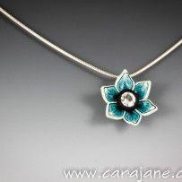 Polymer clay and Swarovski flower pendant by Cara Jane