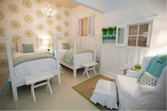Green stenciled medallions with white and aqua bedroom