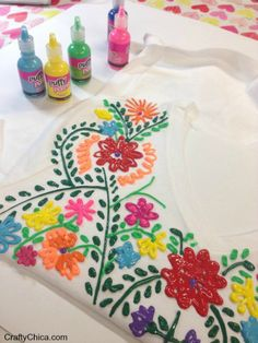 Make your own beautiful no-sew faux Mexican-style embroidered shirt with this fun new tutorial from The Crafty Chica!