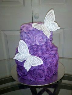 Purple rosettes & Butterflies cake photo