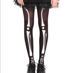 Bundle- 4 pairs of tights! Hot Topic Skeleton tights. Slight run in upper thigh of tights (pic #2); Fishnet tights with flower pattern; pinky lacy tights; and polka dot fishnets. There is small hole in crotch of last pair, but not visible when wearing them. All are a small/medium. Hot Topic Accessories Hosiery & Socks