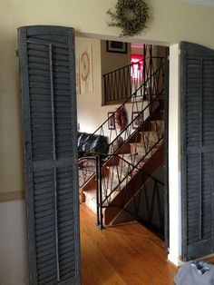 I found these shutters at a salvage yard. They were $10 each. I brushed of the paint in case it was lead based, and sprayed them with a Matte sealer.   They add a little character to the door way.