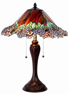 Tiffany table lamp.....love the colors                                                                                                                                                                                 More