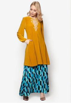 Embellished Kurung from Aqeela Muslimah Wear in Yellow and Multi Modest charm and style definition come together perfectly in this ensemble from Aqeela Muslimah Wear. Comfortable as it is stylish, the combination of beaded top and hypnotizing skirt will certainly redefine your growing collection of conservativ... #bajukurung #bajukurungmoden