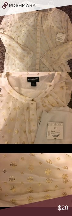Beautiful brand new shirt from Liz Claiborne This sheet cream and gold top is lovely! Brand new! Tag is not attached, but is with this item. The shirt comes with a white camisole to wear underneath. There is a tiny makeup spot on the collar (shown in the last pic) from try on, but this shirt has not been washed or worn. Beautiful! Liz Claiborne Tops Blouses