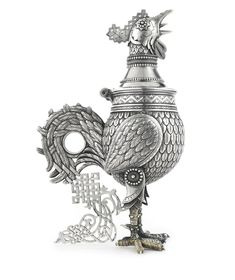 A Russian silver decanter, Alexander Nikolaevich Sokolov, St. Petersburg, circa 1890, in the Russian Style, modeled as a standing cockerel, richly chased to emphasize the texture of the feathers, with a luxurious tail of strapwork ornament, the interior gilded.